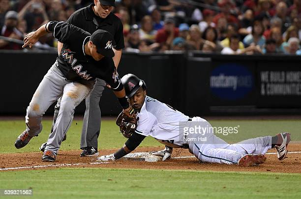 Jean Segura of the Arizona Diamondbacks safely steals third base just ahead of the tag by Martin Prado of the Miami Marlins during the sixth inning...