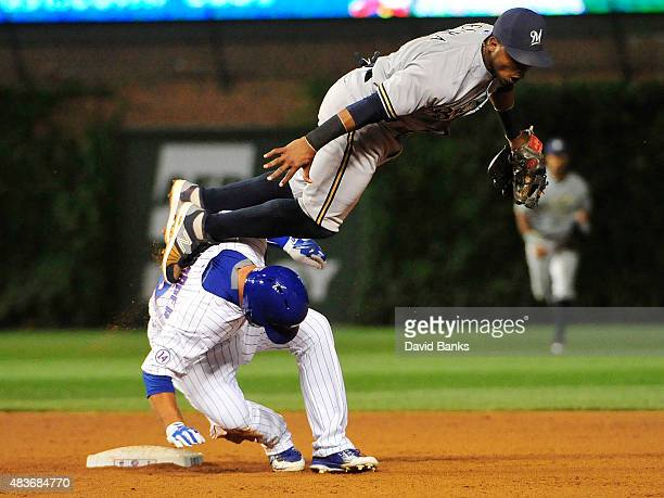 Jean Segura of the Milwaukee Brewers forces out Kyle Schwarber of the Chicago Cubs during the fifth inning on August 11 2015 at Wrigley Field in...