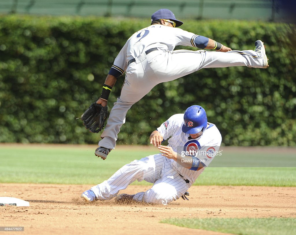 Jean Segura #9 of the Milwaukee Brewers forces out Welington Castillo #5 of the Chicago Cubs during the second inning on September 1, 2014 at Wrigley Field in Chicago, Illinois.
