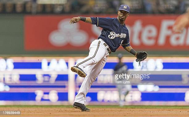 Jean Segura of the Milwaukee Brewers makes a wide throw to first against the St Louis Cardinals in the second inning at Miller Park on August 19 2013...