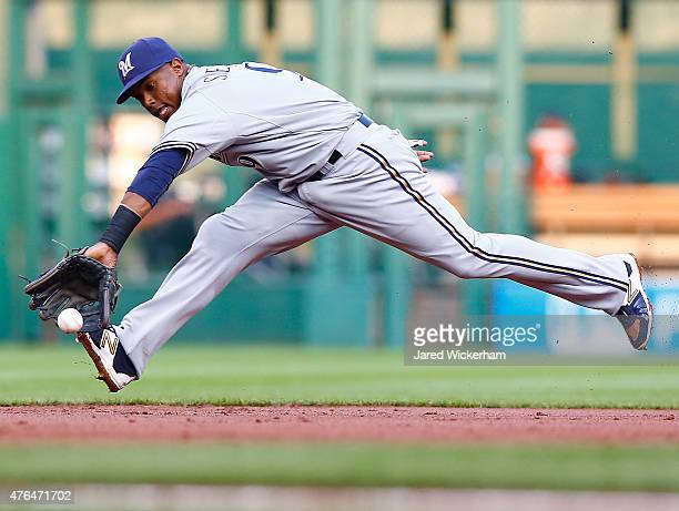 Jean Segura of the Milwaukee Brewers reaches for a ground ball in the second inning against the Pittsurgh Pirates during the game at PNC Park on June...