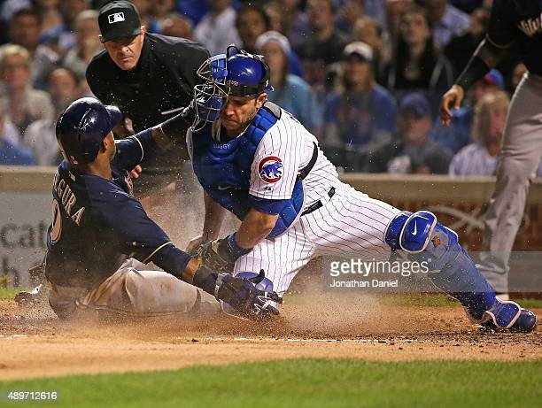 Jean Segura of the Milwaukee Brewers slides in to score a run in the 5th inning as Miguel Montero of the Chicago Cubs is late with the tag at Wrigley...