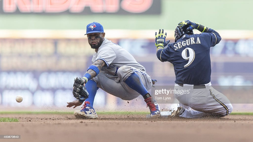 Jean Segura #9 of the Milwaukee Brewers slides into second with a double as Jose Reyes #7 of the Toronto Blue Jays can not make the play at Miller Park on August 20, 2014 in Milwaukee, Wisconsin.