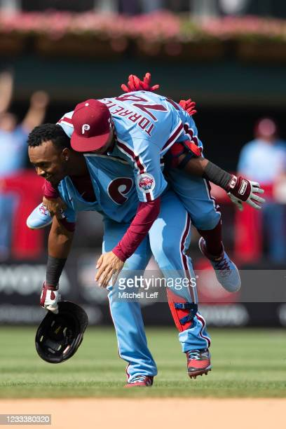 Jean Segura of the Philadelphia Phillies celebrates with Ronald Torreyes after hitting a walk-off two RBI single in the bottom of the tenth inning...
