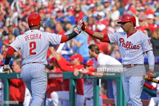 Jean Segura of the Philadelphia Phillies is congratulated by Cesar Hernandez after scoring a run in the fourth inning against the Atlanta Braves on...