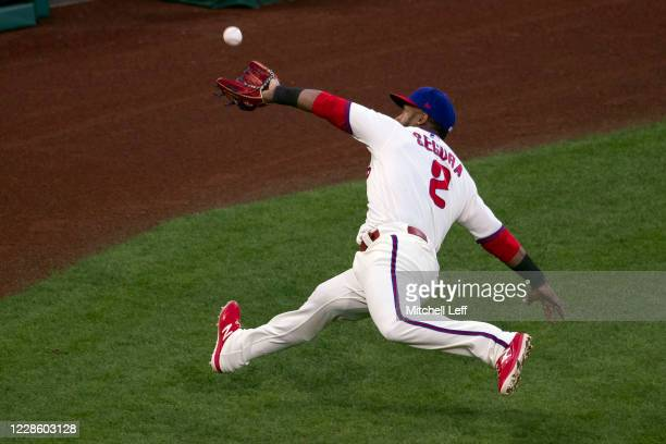 Jean Segura of the Philadelphia Phillies makes a sliding catch on a foul ball hit by Jonathan Villar of the Toronto Blue Jays in the top of the...
