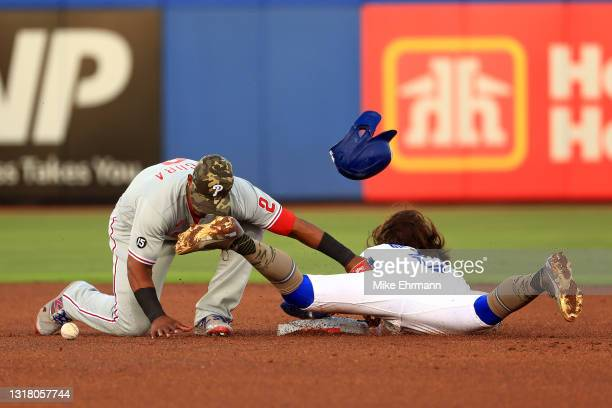 Jean Segura of the Philadelphia Phillies misses the tag as Bo Bichette of the Toronto Blue Jays steals second during a game at TD Ballpark on May 14,...