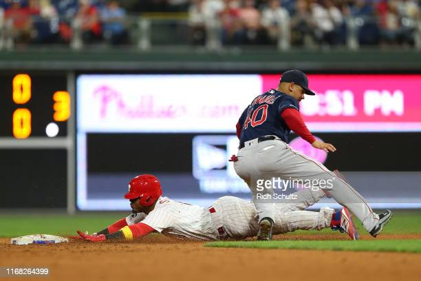 Jean Segura of the Philadelphia Phillies slides past second baseman Marco Hernandez of the Boston Red Sox as he steals second base during the eighth...