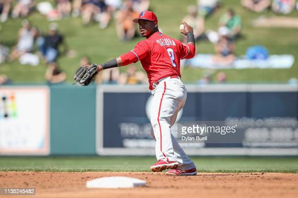 Jean Segura of the Philadelphia Phillies throws to first base in the second inning against the Detroit Tigers during the Grapefruit League spring...