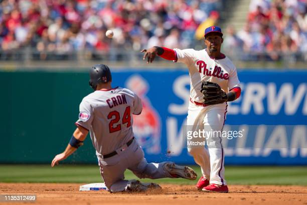 Jean Segura of the Philadelphia Phillies turns a double play against C.J. Cron of the Minnesota Twins in the top of the second inning at Citizens...