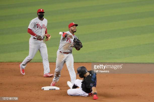 Jean Segura of the Philadelphia Phillies turns the double play for an out on Jorge Alfaro of the Miami Marlins to end the game at Marlins Park on...