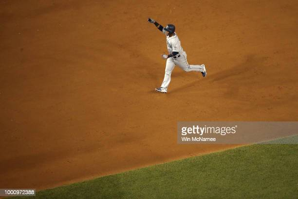 Jean Segura of the Seattle Mariners and the American League celebrates after hitting a threerun home run in the eighth inning against the National...
