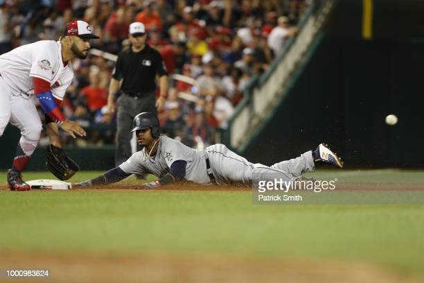 Jean Segura of the Seattle Mariners and the American League slides in to third base in the tenth inning against the National League during the 89th...