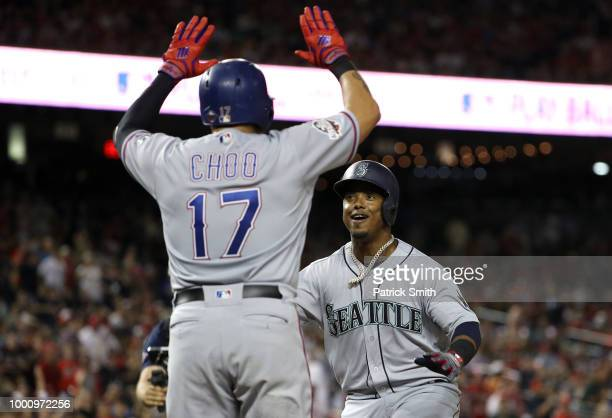 Jean Segura of the Seattle Mariners and the American League celebrates with ShinSoo Choo of the Texas Rangers and the American League after hitting a...