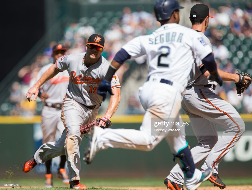 Jean Segura #2 of the Seattle Mariners beats Chris Davis #19 of the Baltimore Orioles for an infield single in the sixth inning at Safeco Field on August 16, 2017 in Seattle, Washington.