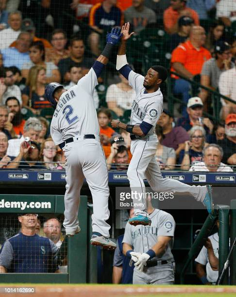 Jean Segura of the Seattle Mariners celebrates with Dee Gordon after hitting a home run in the second inning against the Houston Astros at Minute...