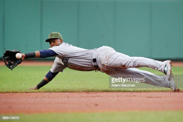 Jean Segura of the Seattle Mariners dives for a ground ball in the first inning of a game against the Boston Red Sox at Fenway Park on May 28 2017 in...