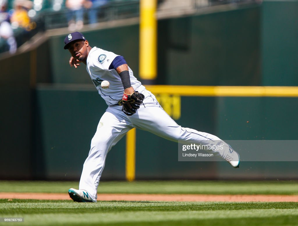 Jean Segura #2 of the Seattle Mariners drops the ball to allow Isiah Kiner-Falefa #9 of the Texas Rangers to reach first base in the fifth inning at Safeco Field on May 16, 2018 in Seattle, Washington.