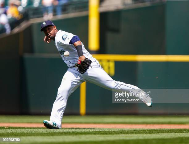 Jean Segura of the Seattle Mariners drops the ball to allow Isiah KinerFalefa of the Texas Rangers to reach first base in the fifth inning at Safeco...