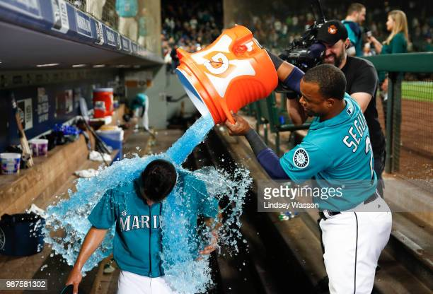 Jean Segura of the Seattle Mariners dumps ice on Marco Gonzales who pitches his first career complete game against the Kansas City Royals at Safeco...