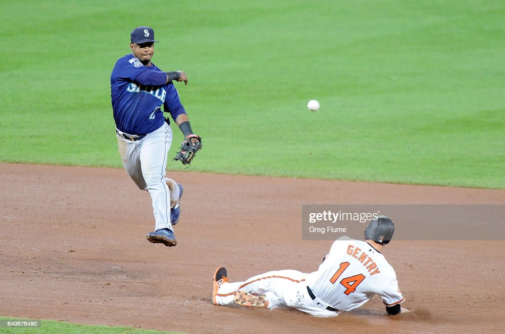 Jean Segura #2 of the Seattle Mariners forces out Craig Gentry #14 of the Baltimore Orioles to start a double play in the fifth inning at Oriole Park at Camden Yards on August 29, 2017 in Baltimore, Maryland.