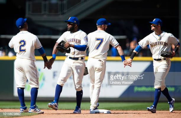 Jean Segura of the Seattle Mariners greets Denard Span and Andrew Romine greets Mitch Haniger right after their win over the Toronto Blue Jays at...