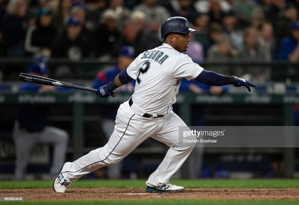 Jean Segura #2 of the Seattle Mariners hits a single off of relief pitcher Tony Barnette #43 of the Texas Rangers during the sixth inning of a game at Safeco Field on May 30, 2018 in Seattle, Washington.