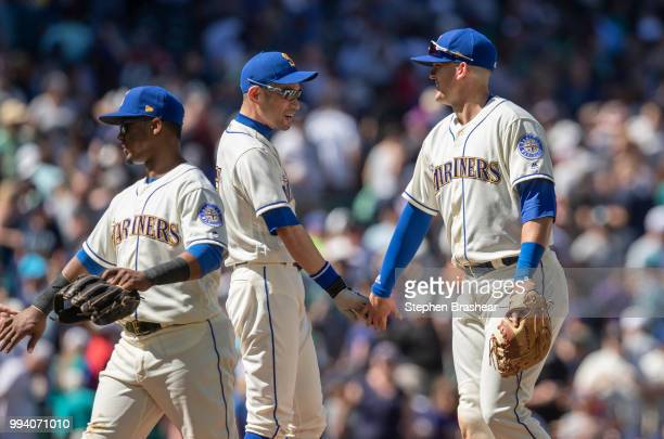 Jean Segura of the Seattle Mariners Ichiro Suzuki of the Seattle Mariners and Ryon Healy of the Seattle Mariners celebrate after a game against the...