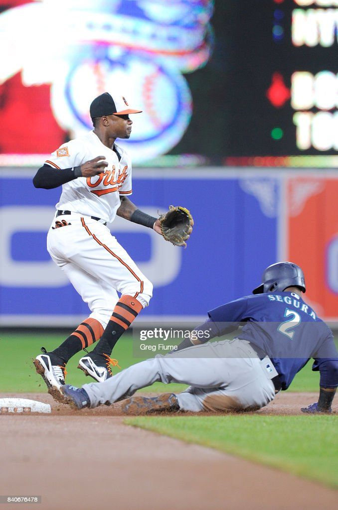 Jean Segura #2 of the Seattle Mariners is forced out at second base in the first inning by Tim Beckham #1 of the Baltimore Orioles at Oriole Park at Camden Yards on August 29, 2017 in Baltimore, Maryland.