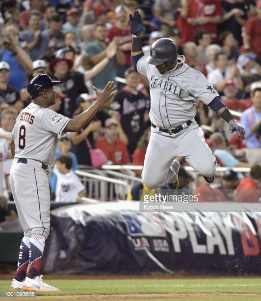 Jean Segura of the Seattle Mariners reacts after he hits a threerun pinchhit home run during the eighth inning of the Major League Baseball AllStar...