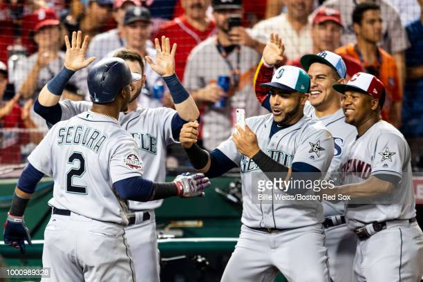 Jean Segura of the Seattle Mariners reacts with teammates after hitting a three run home run during the eighth inning of the 89th MLB AllStar Game at...