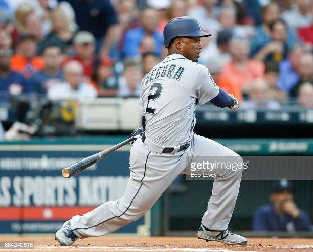 Jean Segura of the Seattle Mariners singles in the first inning against the Houston Astros on Opening Day at Minute Maid Park on April 3 2017 in...