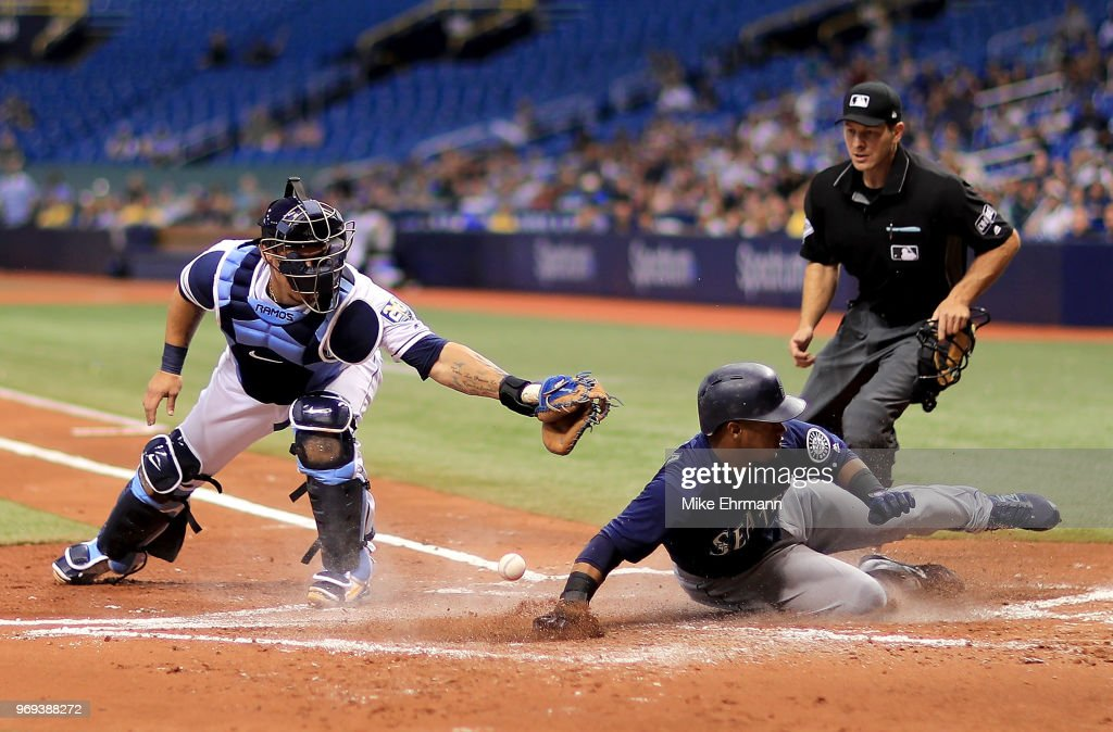 Jean Segura #2 of the Seattle Mariners slides in front of the tag from Wilson Ramos #40 of the Tampa Bay Rays in the second inning during a game at Tropicana Field on June 7, 2018 in St Petersburg, Florida.