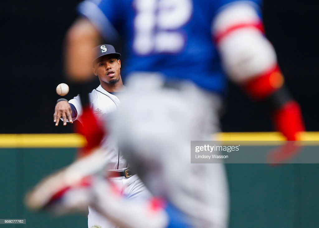 Jean Segura #2 of the Seattle Mariners throws out Rougned Odor #12 of the Texas Rangers at first base in the third inning at Safeco Field on May 16, 2018 in Seattle, Washington.