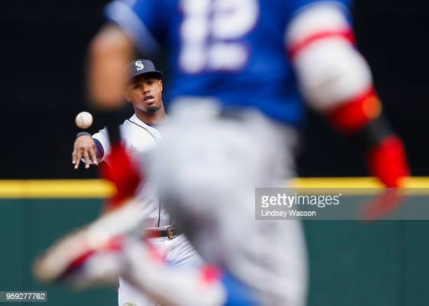 Jean Segura of the Seattle Mariners throws out Rougned Odor of the Texas Rangers at first base in the third inning at Safeco Field on May 16 2018 in...