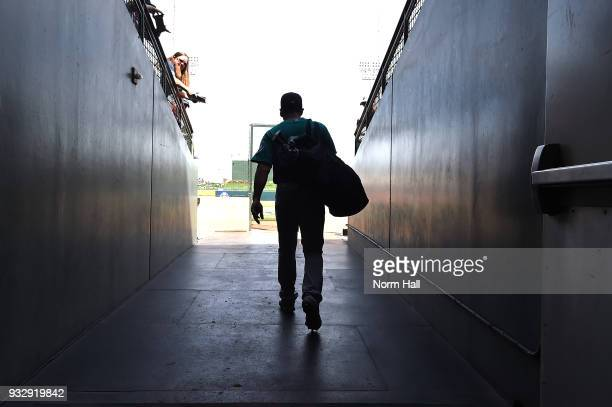 Jean Segura of the Seattle Mariners walks to the field prior to a spring training game against the Texas Rangers at Surprise Stadium on March 16 2018...