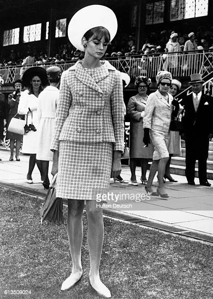 Jean Shrimpton the English fashion model and international figure of the 1960s attracts the interest of passersby at the Melbourne Cup