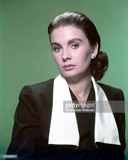 Jean Simmons Britiish actress wearing a black jacket with white lapels in a studio portrait against a green background circa 1950
