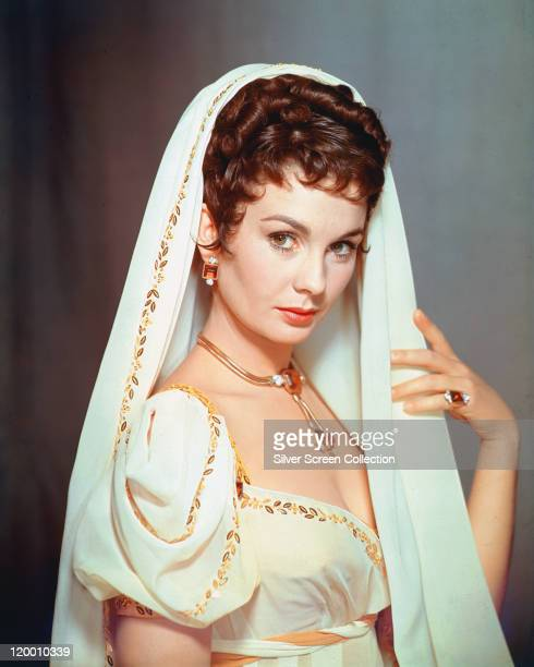 Jean Simmons Britiish actress wearing a white dress with gold trim and a matching veil in a publicity portrait issued for the film 'Desiree' 1954 The...