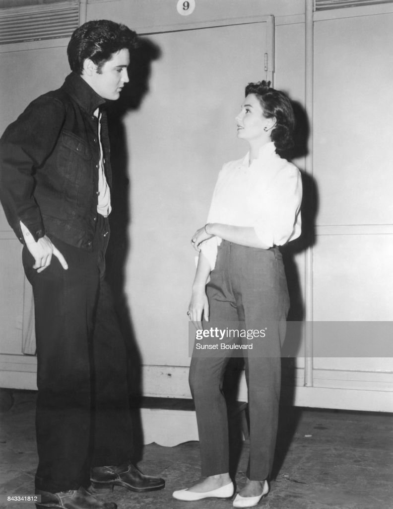 Jean Simmons with singer and actor Elvis Presley on the set of Jailhouse Rock directed by Richard Thorpe.