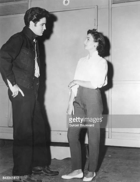Jean Simmons with singer and actor Elvis Presley on the set of Jailhouse Rock directed by Richard Thorpe