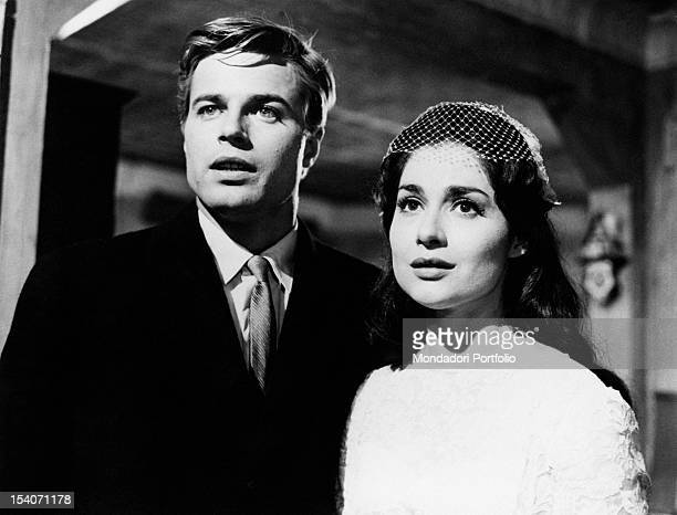 Jean Sorel and Carol Lawrence in a scene from the movie A View from the Bridge the actors are worried and anxious they gaze into the distance in the...