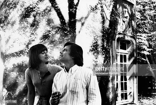 Jean Sorel and his wife Anna Maria Ferrero are in a garden the French actor smokes a cigarette and looks up while Anna Maria Ferrero is looking at...