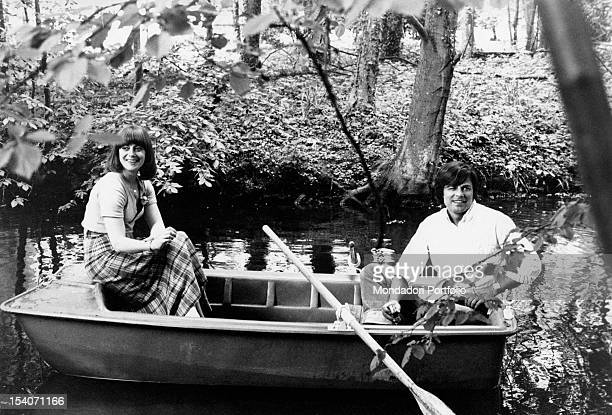 Jean Sorel and his wife Anna Maria Ferrero both smiling are seated on a little rowing boat along a river the place is surrounded by a flourishing...