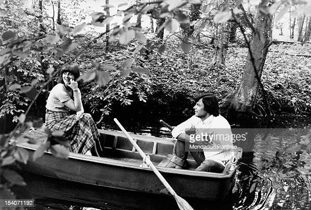Jean Sorel with his wife Anna Maria Ferrero on a little boat along a river Aulnay 1970