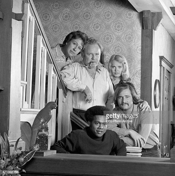 """Jean Stapleton as Edith Bunker, Carroll O'Connor as Archie Bunker, Sally Struthers as Gloria Bunker-Stivic, Rob Reiner as Michael """"Meathead"""" Stivic..."""