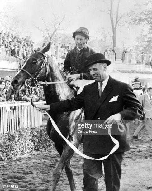 Jean Ternynck leads in his horse Sea Bird II ridden by Australian jockey Pat Glennon after they won the Prix de l'Arc de Triomphe at the Longchamp...