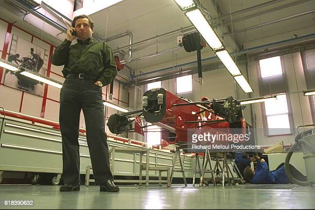 Jean Todt in front of a Ferrari F310