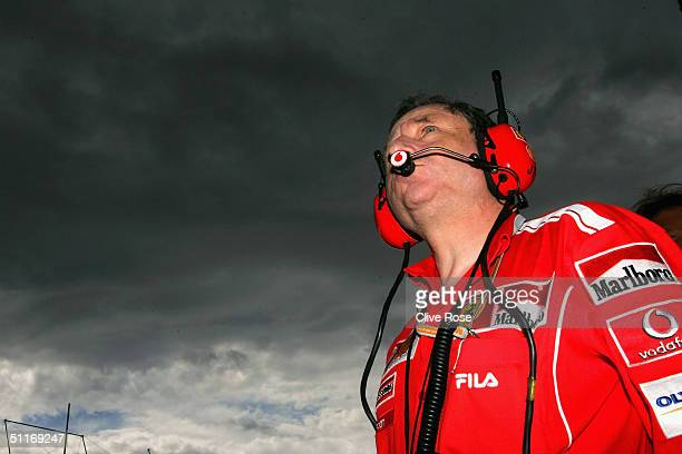 Jean Todt of Ferrari looks at the incoming bad weather during the qualifying session for the Hungarian F1 Grand Prix at the Hungaroring Circuit on...