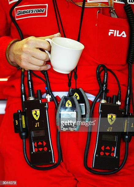Jean Todt of the Ferrari Formula One Team has a cup of tea in the pits during practice for the 2004 Australian Grand Prix which is round one of the...
